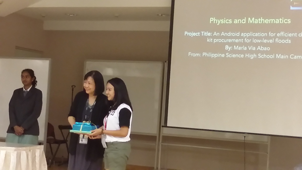 "Marla Abao, a student from the Philippine Science High School (PSHS) Main Campus, received the Best Oral Presentation award for her paper titled ""An Android Application for Efficient Disaster Kit Procurement for Low-Level Floods"" at the International Student Science Fair 2016 held in Singapore. (Contributed photo)"