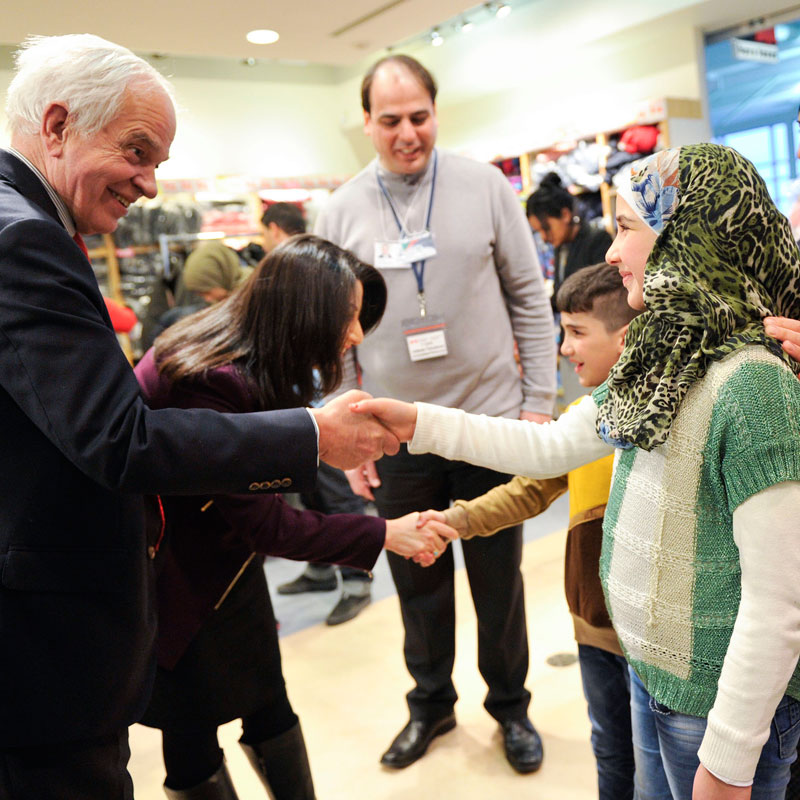 FILE photo: Ministers John McCallum and Maryam Monsef welcome a Syrian family to Canada. (Photo: Government of Canada website)