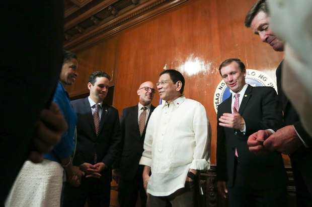 """President Rodrigo """"Rody"""" Duterte chats with members of the US Congressional delegation during a courtesy call at the President's Hall in Malacañan Palace on July 19. (Photo: King Rodriguez/PPD)"""