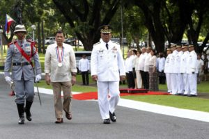 "President Rodrigo ""Rody"" Duterte (center) trooping the line escorted by  Armed Forces of the Philippines Chiefs of Staff   Ricardo Visaya (right) during the  rites Honoring the Country's National Heroes Day at the Libingan ng mga Bayani in Taguig City  (Photo: Avito Dalan/PNA)"