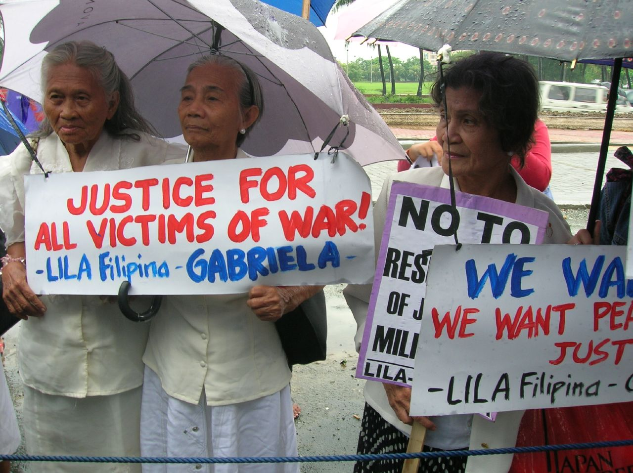 FILE PHOTO: Members of Lila-Filipina, a group composed of comfort women from the Japanese occupation era, rally infront of the Japanese Consulate in August 2006. (Photo by TQT/Flickr)