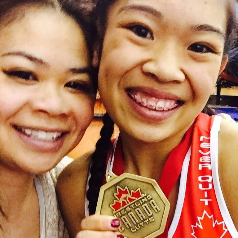Calista Espinosa celebrates win at Cadet Canadian Championships with mother, Mylene. (Photo courtesy of the Espinosas)