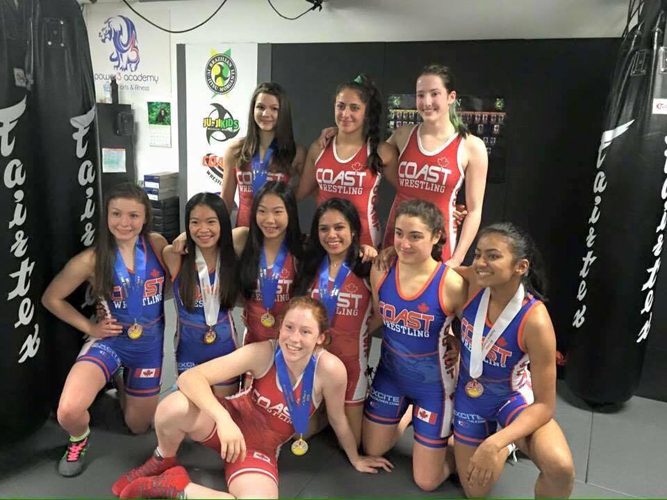 Calista Espinosa, middle, second from left, with fellow wrestlers from Coast Wrestling Club. (Photo courtesy of the Espinosas)