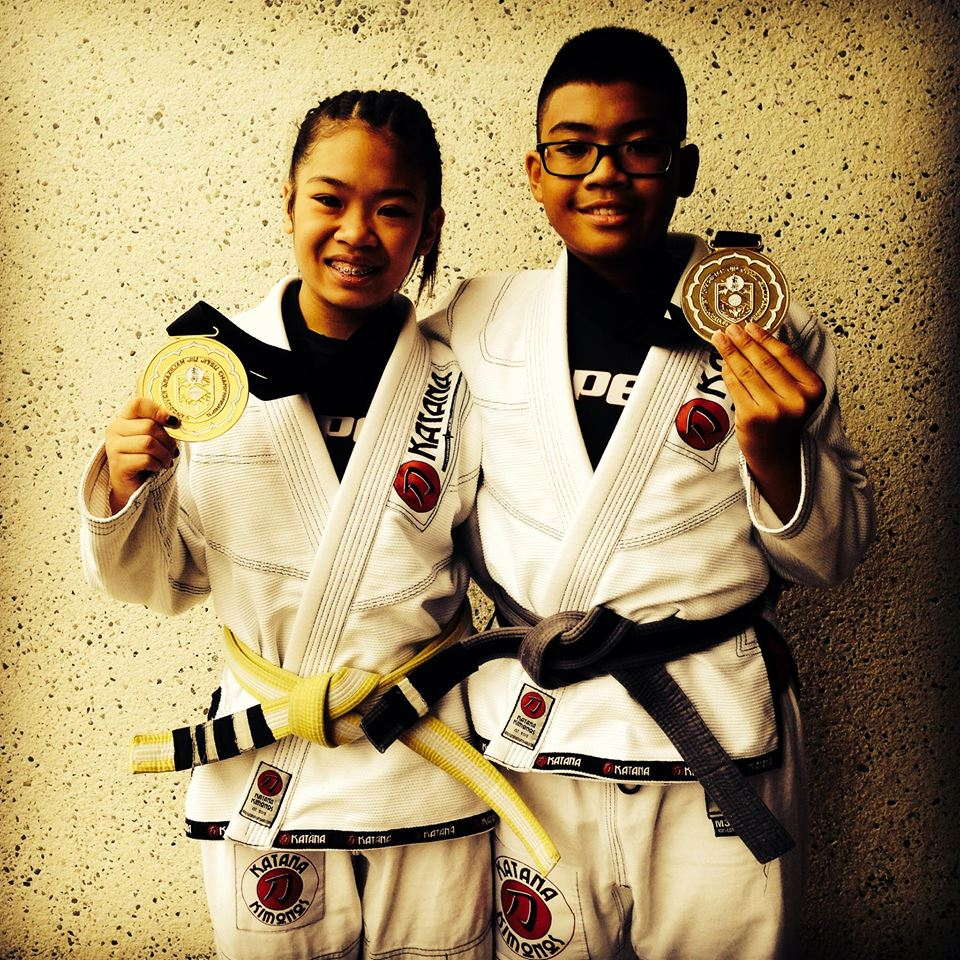 WRESTLING SIBLINGS: Big sister Calista and brother Xavier show off their medals. (Photo courtesy of the Espinosas)