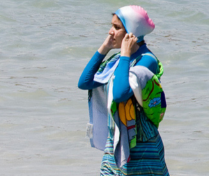 Even though it's only worn by a tiny minority, the burkini – a wetsuit-like garment that covers the torso, limbs and head – has prompted a national discussion about Islam and women's bodies. (Photo: Giorgio Montersino/Flickr)