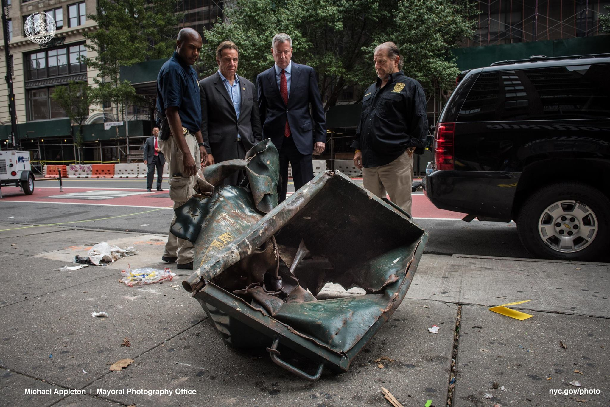 New York governor Andrew Cuomo (second from left) and the city mayor Bill de Blasio (third from left) walk through the site of incident in Chelsea (Photo: Bill de Blasio/Facebook)