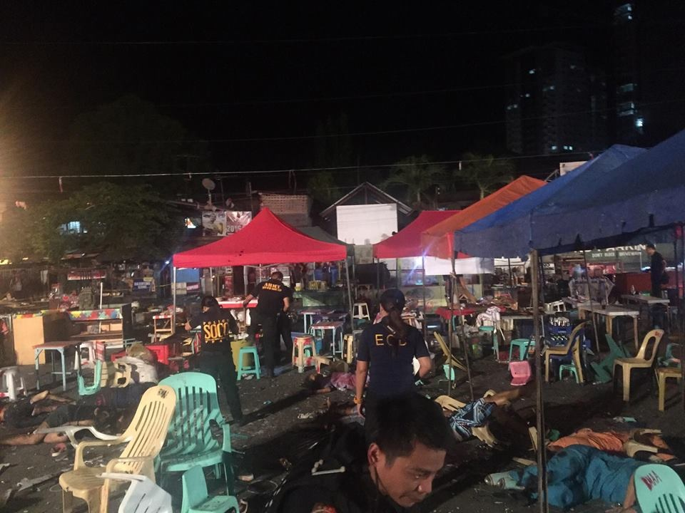Teams from the Scene of the Crime Operatives (SOCO) and the Explosives and Ordnance Division (EOD) of the Philippine National Police in Davao scour the blast site where an explosion ripped through a crowded night market along Roxas Avenue in Davao City around 10:00 p.m. on Friday (Sept. 2, 2016). (Photo: Ayan Mellejor/PNA)