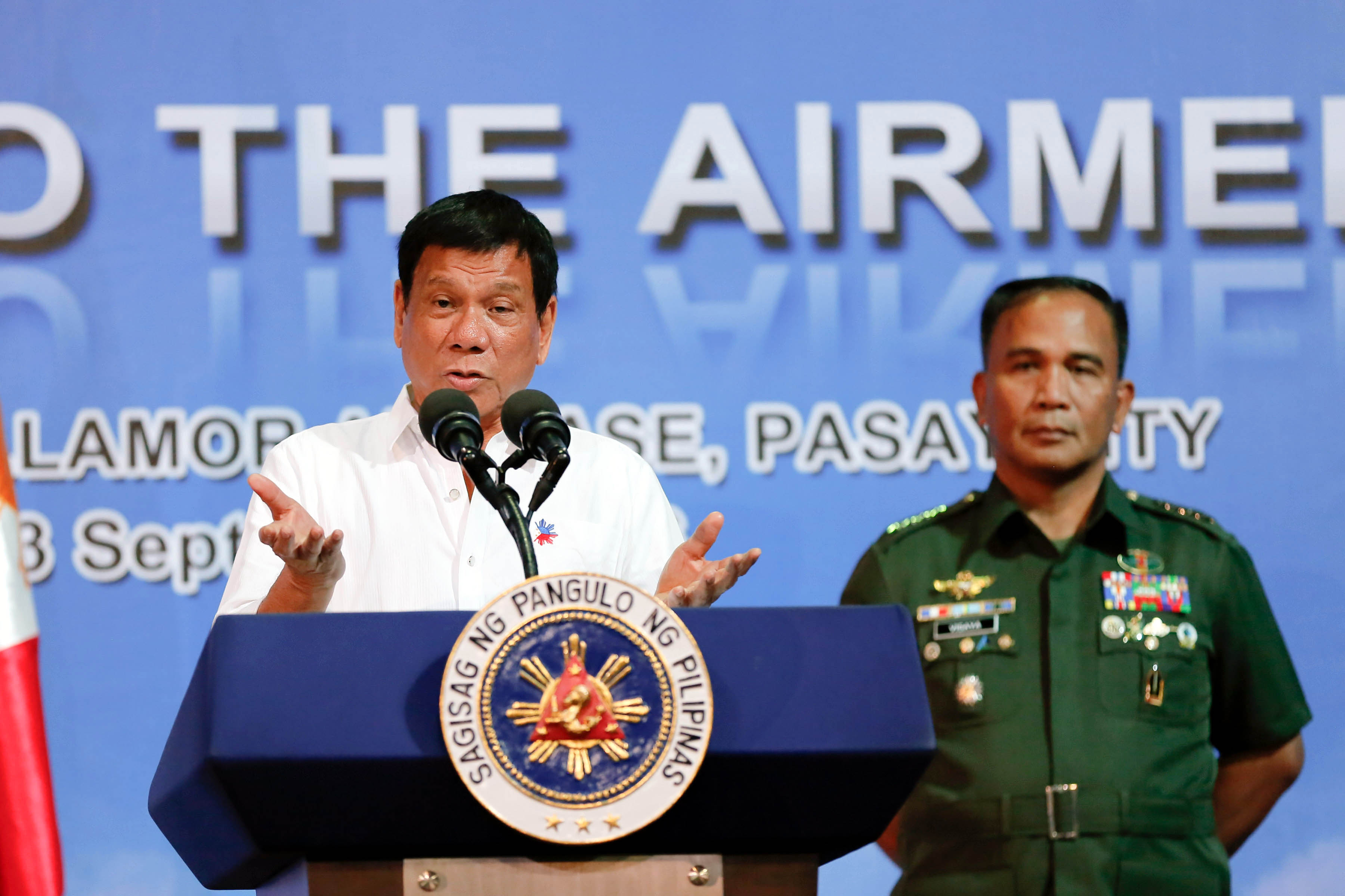 "President Rodrigo ""Rody"" Duterte delivering his speech before airmen at the Villamor Air Base in Pasay City on Sept. 13, 2016. Beside him is Armed Forces of the Philippines (AFP) Chief of Staff Gen. Ricrdo Visaya. (Photo: Toto Lozano/PPD/PNA)"