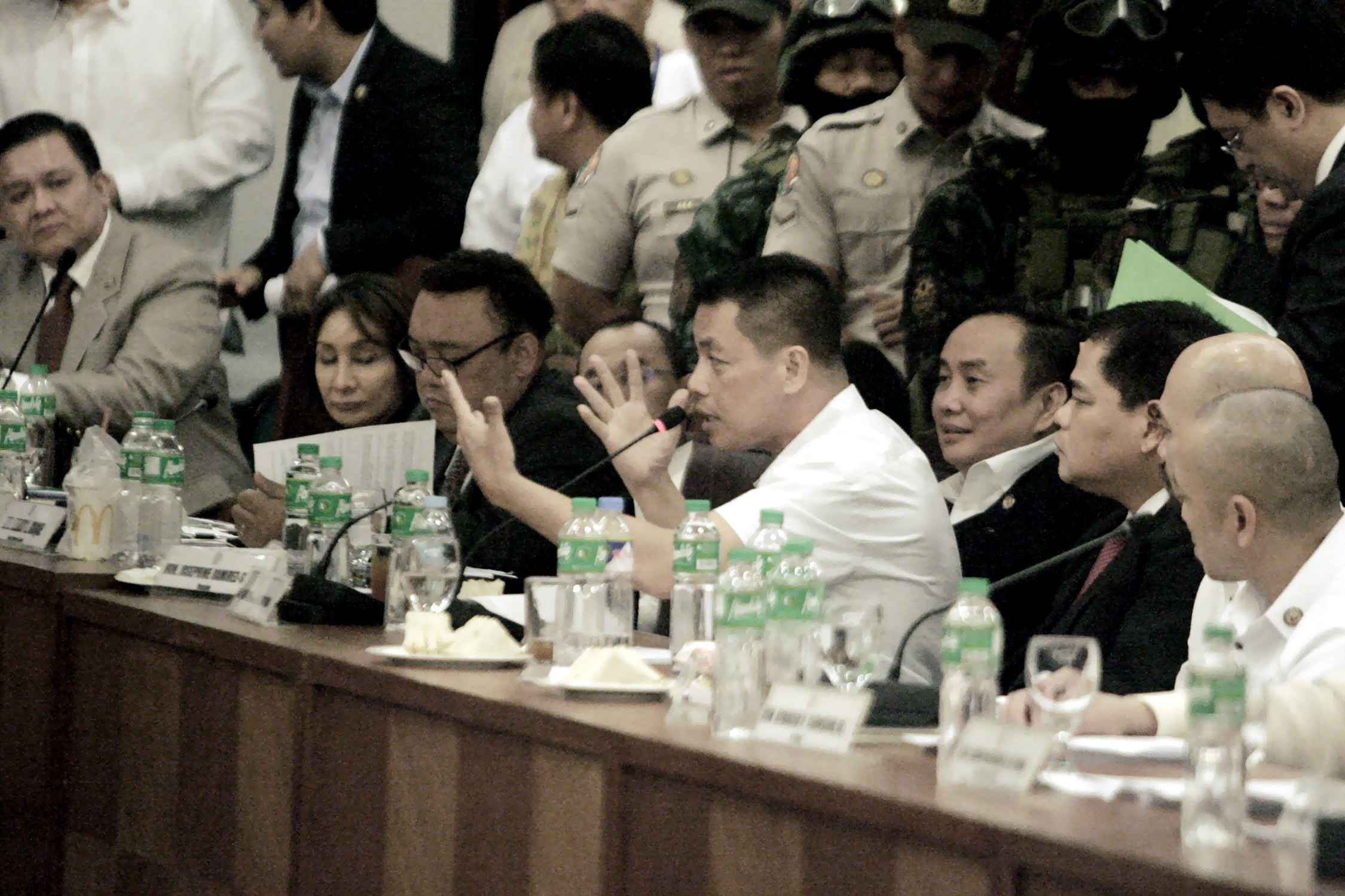 Convicted drug lord Herbert Colangco (4th from left) gestures with both hands to stress a point in his testimony against Senator Leila de Lima during the hearing of the House of Representatives Justice Committee on the proliferation of drug trade inside the New Bilibid Prison on Tuesday (Sept. 20, 2016). He claimed that De Lima received PHP3 million a month since October 2013 to allow illegal transactions inside the NBP. (Photo: Oliver Marquez/PNA)