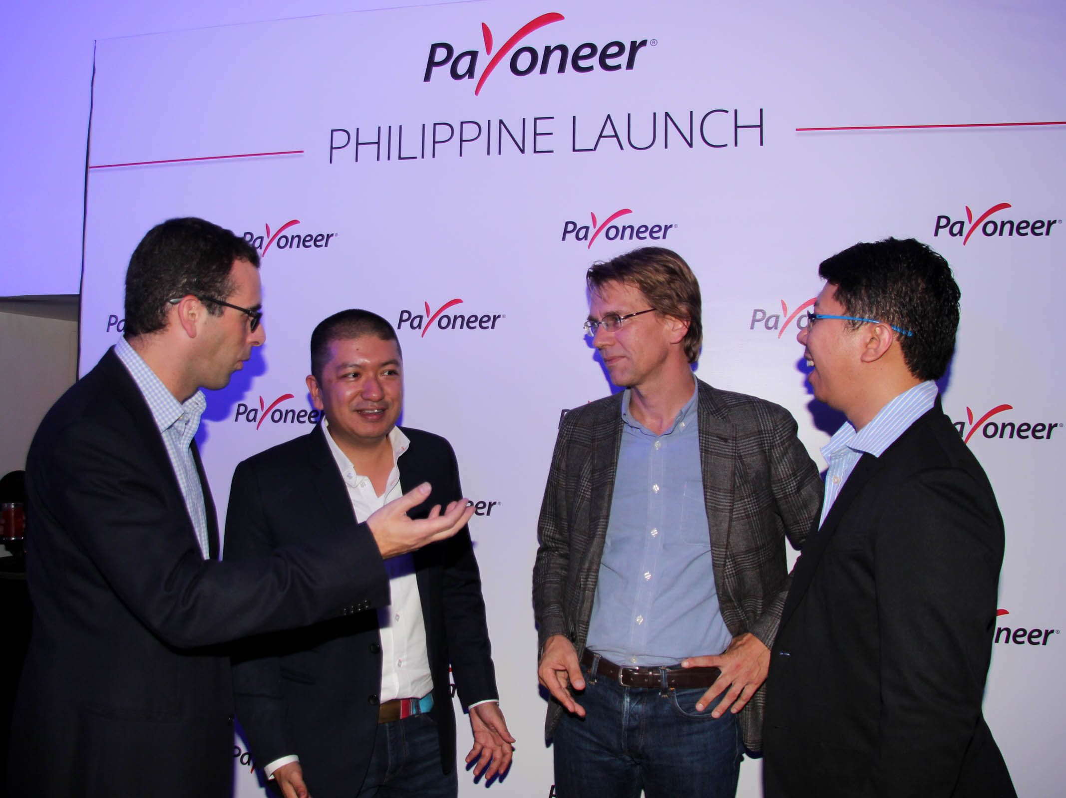 Photo shows (from left) Jonny Stell, VP for Marketing of Payoneer; Miguel Warren, Country Manager, Payoneer Philippines; Patrick de Councy, Head of Asia-Pacific, Payoneer; and Allan Donato, Payoneer Brand Ambassador exchange views during the Payoneer Philippine Launch on Thursday (Sept. 22, 2016) at BGC (The Fort Strip) in Taguig City. Headquartered in New York City, Payoneer is a leading online payments company transforming the way businesses send and receive cross-border payments. (Photo: Gil Calinga/PNA)
