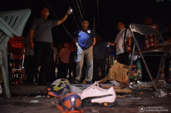 Duterte surveys the crime scene of Sept 12 Davao blast. (PCO photo)