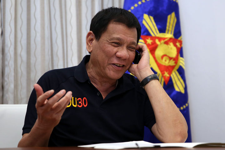 President Rody Duterte talks with incoming U.S. President Donald Trump over the phone on Friday evening, December 2. (Malacañang photo)