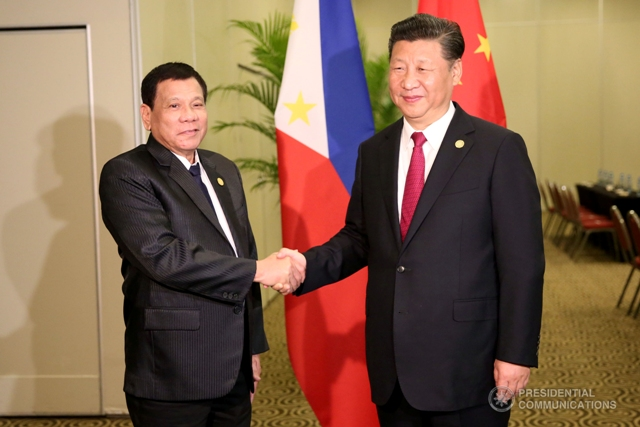 President Rodrigo Duterte and Chinese President Xi Jinping greet each other at Asia-Pacific Economic Cooperation (APEC) Leaders' Summit in Lima, Peru on November 19m 2016. (REY BANIQUET/ Presidential Photo)