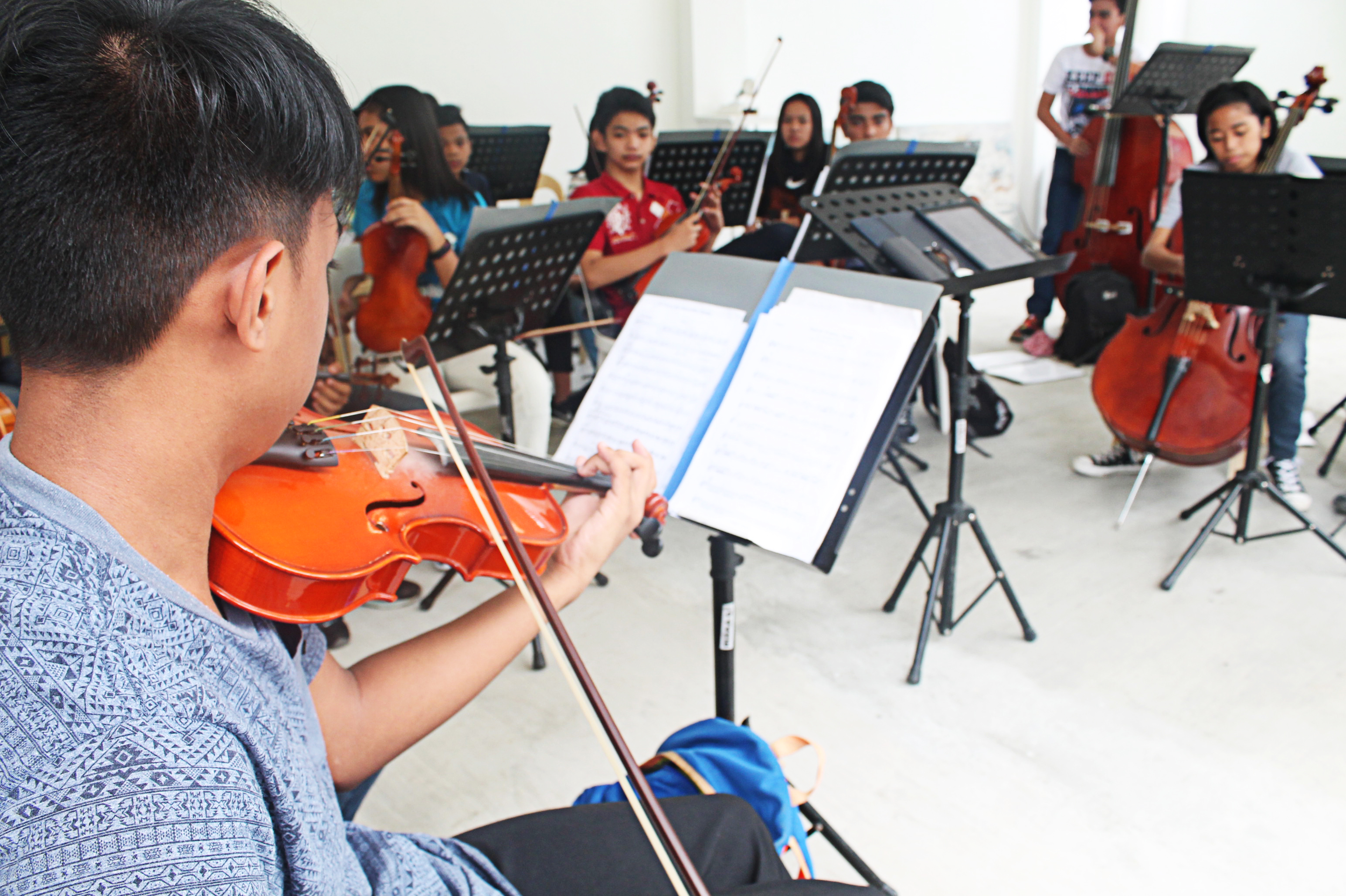 Young Regional Lead School for the Arts in Angono (RLSAA) palying instrument at the rehearsal
