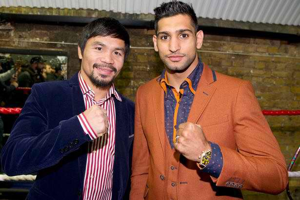 WBO world welterweight champion Manny Pacquiao and Amir Khan say they have agreed to terms for a fight on April 23. (Photo: Manny Pacquiao/ Facebook)