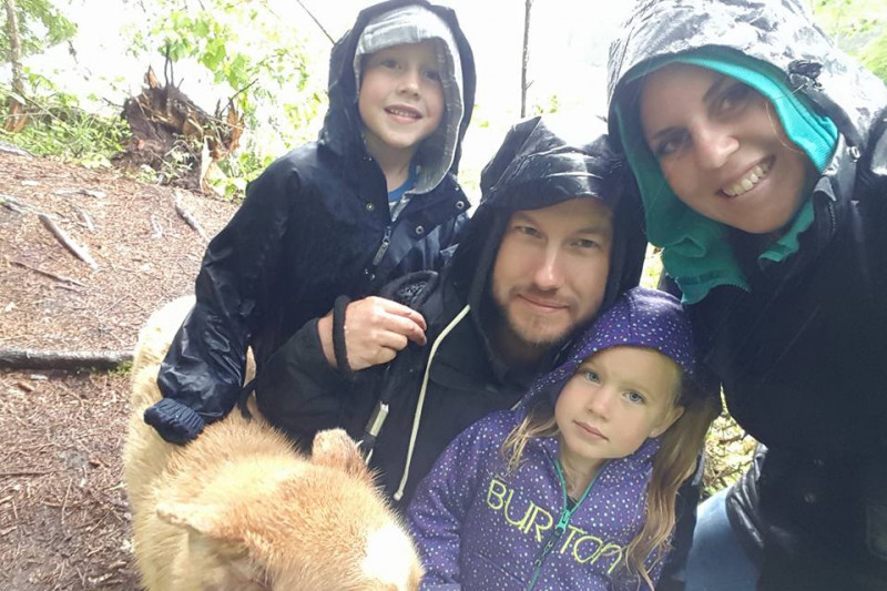 The couple and their two young children had been on their way to Vancouver to board a flight for a family vacation in Hawaii when they were first to arrive on the scene of a jack-knifed utility trailer. (Photo: Jenell Kornelson  via Gofundme)