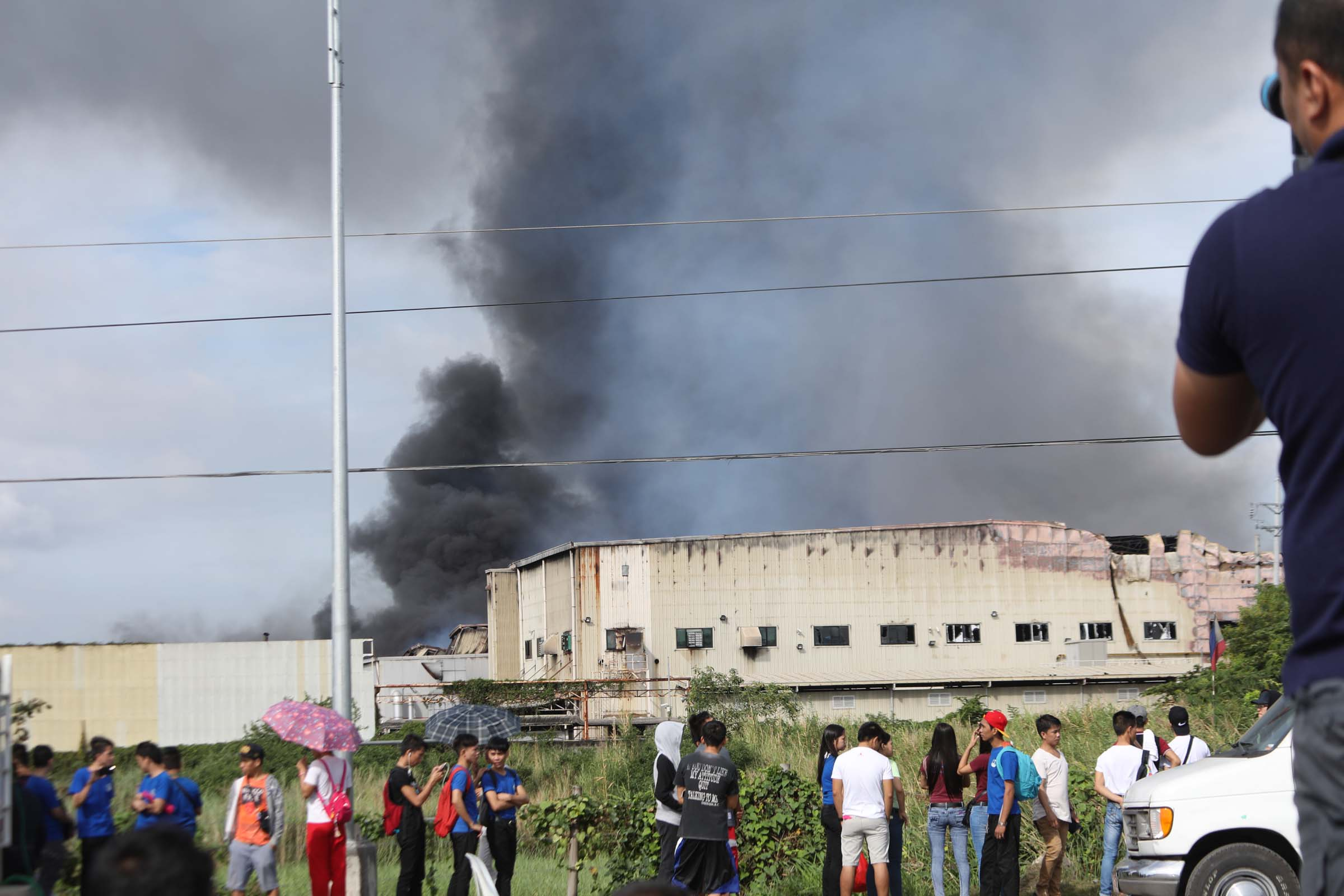 Thick black smoke continues to billow 15 hours after a huge blaze gutted the HTI factory inside the Cavite Export Processing Zone on Thursday (February 2, 2017) in Rosario, Cavite. Fire started Wednesday afternoon and destroyed the House Technology Industries factory complex leaving more than a hundred workers injured and several others unaccounted for.(PNA photo by Avito C.Dalan)