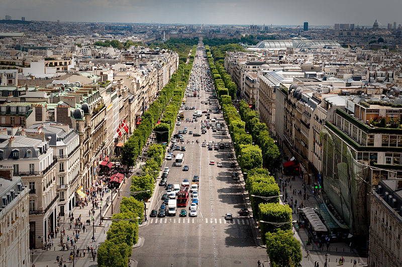 A gunman opened fire on police on Paris' iconic Champs-Elysees boulevard Thursday night, killing one officer and wounding three people before police shot and killed him. The Islamic State group quickly claimed responsibility for the attack. (Photo by Josh Hallett (Flickr: The Champs) [CC BY-SA 2.0 (http://creativecommons.org/licenses/by-sa/2.0)])