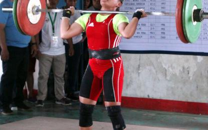 The 18-year-old athlete from Tagbilaran City lifted 73 kg. in the jerk and 95 kg. in snatch for a total of 168 kg. in her new weight category. (Photo: Philippine News Agency)