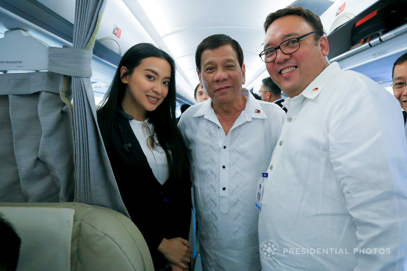 FILE: President Rodrigo Roa Duterte poses for a photo with Presidential Communications Assistant Secretary Margaux 'Mocha' Uson and Presidential Spokesperson Harry Roque while on board the Philippine Airlines chartered flight prior to their departure for Vietnam on November 8, 2017. ALBERT ALCAIN/PRESIDENTIAL PHOTO