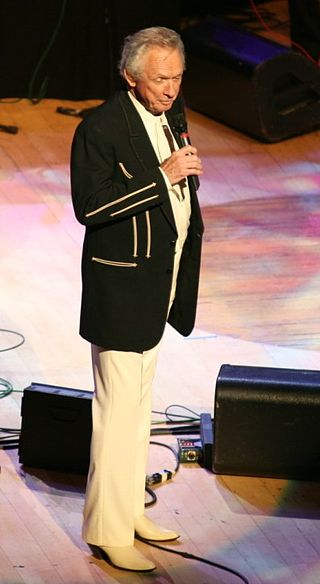 Mel Tillis at the Grand Ole Opry, 2007 (Photo By Cliff - originally posted to Flickr as Mel Tillis, CC BY 2.0)