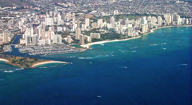 Aerial view of Waikiki (Photo By Travis.Thurston - Own work Derivative of w:File:Waikiki from the air.jpg from author JeffreyAllen1975 uploaded 2005-11-29 to English Wikipedia - Properly named, cropped image, CC BY-SA 3.0)