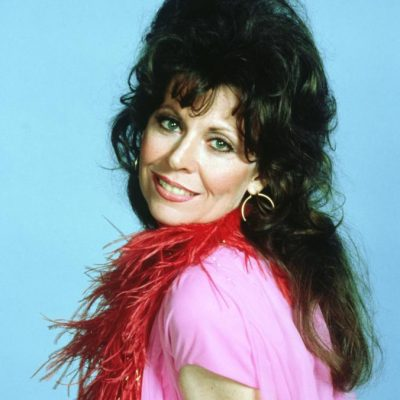"She's perhaps best known for the TV sitcom ""Three's Comedy,"" where she played Lana Shields, an older woman with her eyes set on her young neighbour Jack, played by John Ritter. (Photo by threescompany.com)"