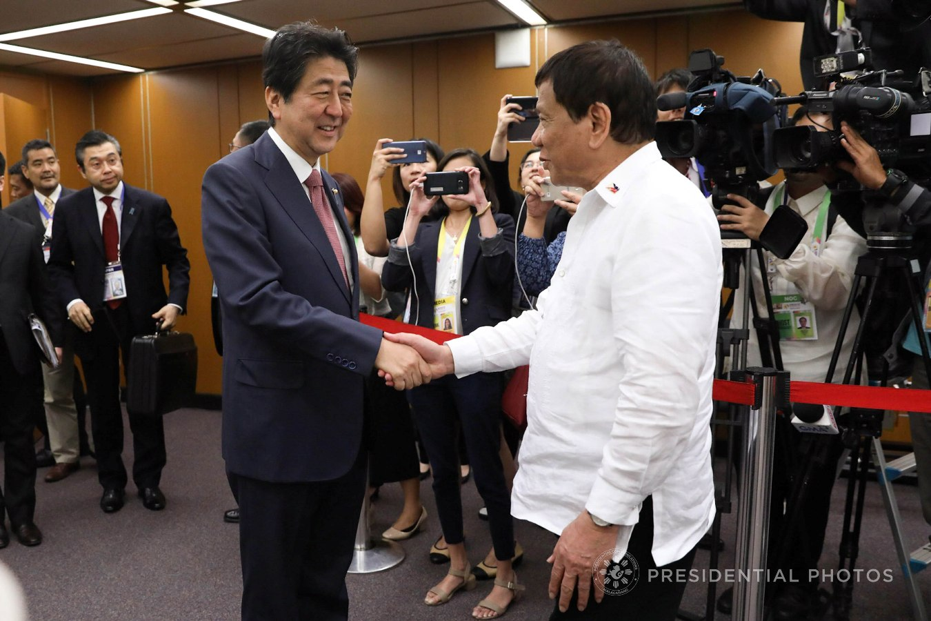 FILE: President Rodrigo Roa Duterte gives a warm welcome to Japan Prime Minister Shinzo Abe prior to the start of their bilateral meeting at the Philippine International Convention Center in Pasay City on November 13, 2017. ROBINSON NIÑAL JR./PRESIDENTIAL PHOTO
