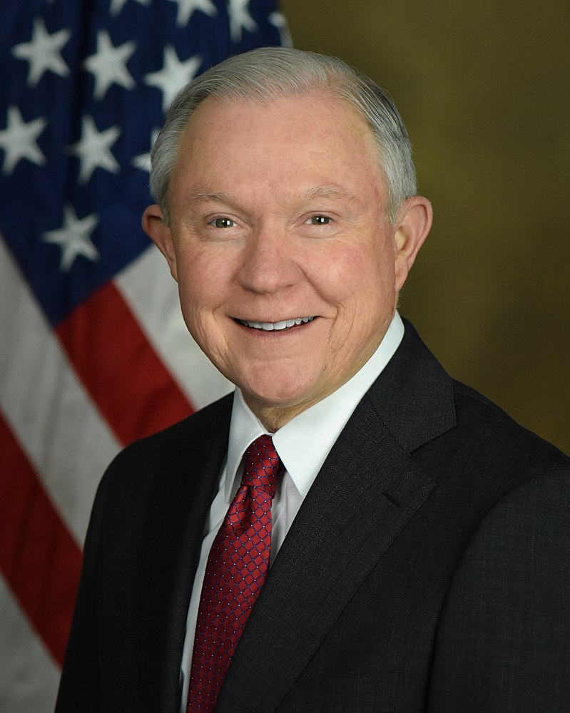 Jeff Sessions (Photo by United States Department of Justice - https://www.justice.gov/sites/default/files/styles/staff_profile/public/staff-profiles/images/2017/03/02/ag_sessions_official_photo-small.jpg, Public Domain)