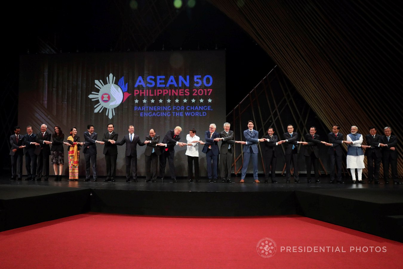 President Rodrigo Roa Duterte and the rest of the leaders from the Association of Southeast Asian Nations (ASEAN) member states and dialogue partners do the traditional ASEAN handshake as they pose for a photo during the opening of the 31st ASEAN Summit and Related Summits at the Cultural Center of the Philippines in Pasay City on November 13, 2017. The dialogue partners include New Zealand, Timor-Leste, Republic of Korea, USA, Australia, India, China, and Japan. ROBINSON NIÑAL JR./PRESIDENTIAL PHOTO
