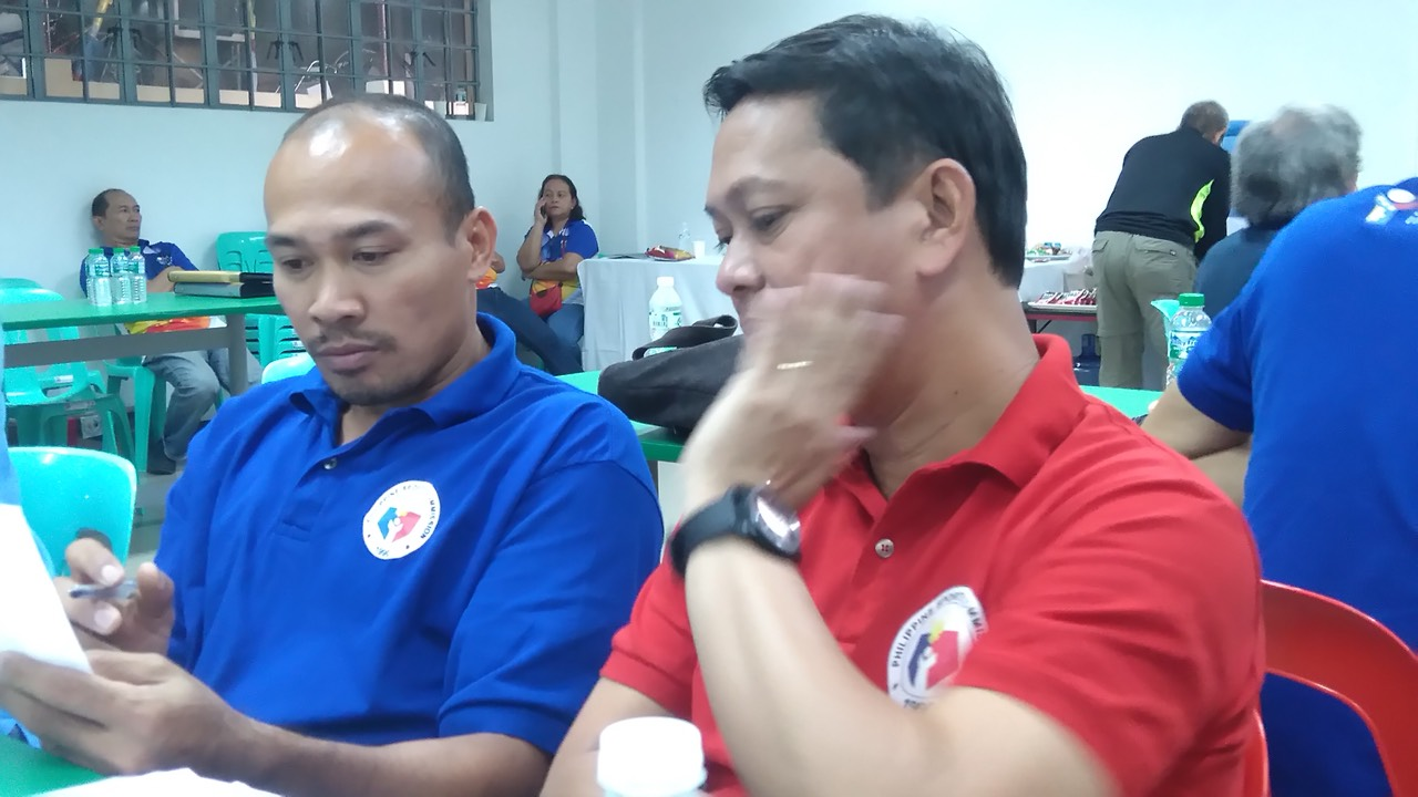 DIRECTION. Philippine Sports Commissioner Charles Raymond A. Maxey (right) listens to Philippine Sports Institute (PSI) Socsksargen coordinator Henry Dagmil during a workshop on formulating targets for 2018 as the PSI Coordinators' Meeting and Workshop came to a close at the Multipurpose Hall Dorm G, PhilSports Complex in Pasig City on November 29, 2017. (PSC-PSI Photo)