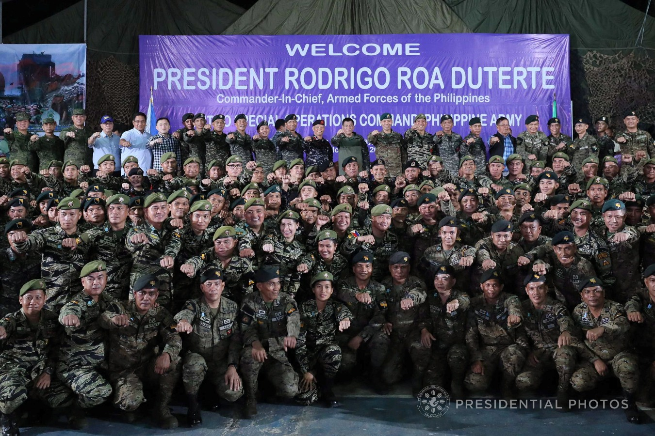 FILE: President Rodrigo Roa Duterte flashes his signature pose in a photo opportunity with the officials and personnel from the Light Reaction Regiment, Special Operation Command, First Scout Ranger Regiment, and Special Forces Regiment Airborne during his visit at Fort Magsaysay in Palayan City, Nueva Ecija on November 22, 2017. ACE MORANDANTE/PRESIDENTIAL PHOTO