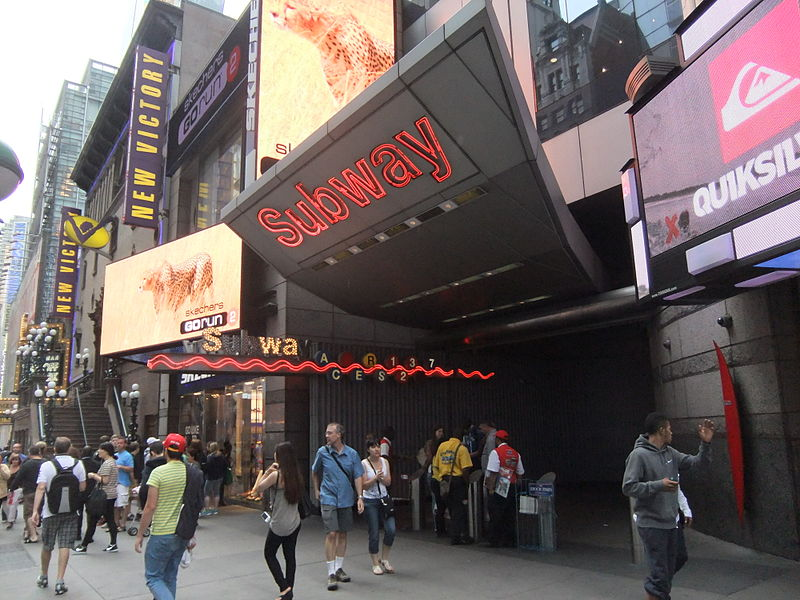 An entrance to the Times Square–42nd Street/Port Authority Bus Terminal station. (Photo By Harrison Leong - Own work, CC BY-SA 3.0)