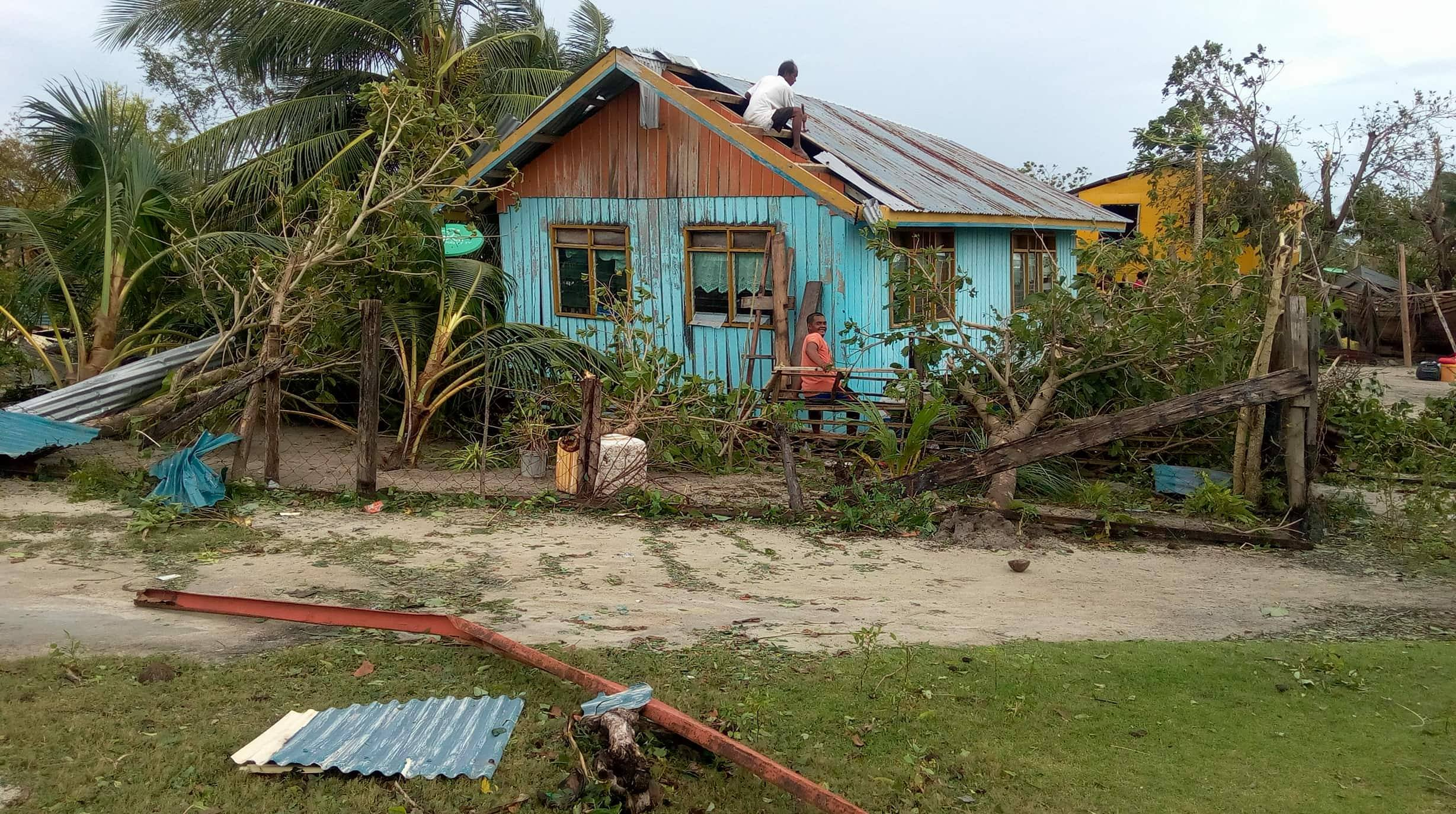 Homeowners in Mangsee Island are seen in this photo fixing the roof of their house damaged by Tropical Storm Vinta. (Photo by Capt. Wanel Ansa of MBLT4)