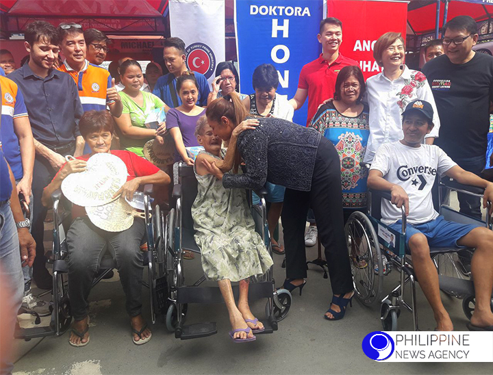 FREE WHEELCHAIRS. Aside from free medical check-up, Manileños who attended a medical mission conducted by Turkish International Cooperation and Coordination Agency (TIKA), in partnership with Manila City government, receive wheelchairs. (PNA Photo)