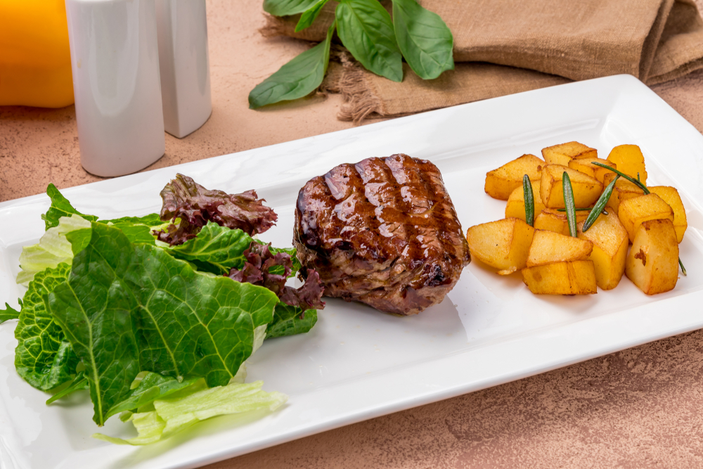 Want to serve a fancy roast for Christmas dinner without breaking the bank? Try a petite beef filet. Cut from the shoulder, long and thin, and weighing between 8-10 ounces, the petite filet looks like a mini tenderloin of beef—one of the priciest and most popular of roasts. (Shutterstock)