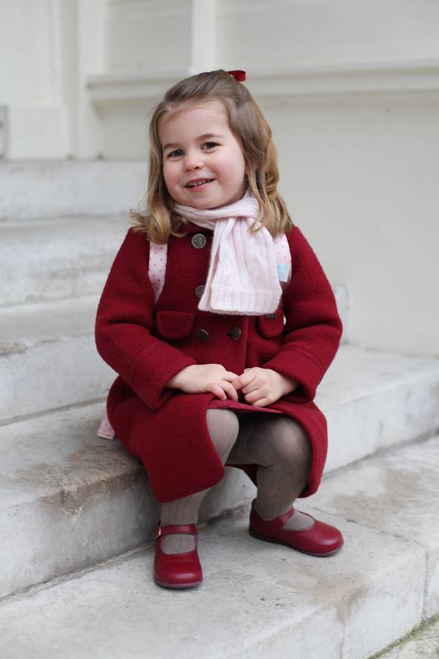 The 2-year-old is shown on the steps of the palace in one photo and standing holding onto a rail in another. (Photo: The Royal Family/Facebook)