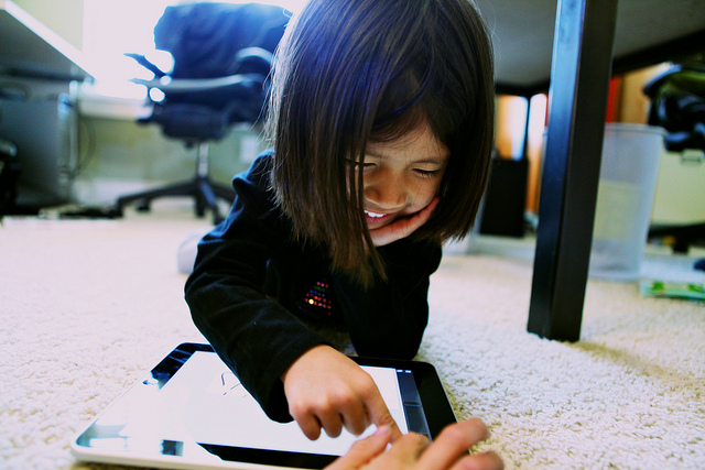 Child development experts and advocates are urging Facebook to pull the plug on its new messaging app aimed at kids. (Photo by Marcus Kwan/Flickr, CC BY-SA 2.0)