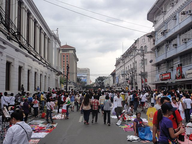 Street scene near Plaza Roma along A. Soriano Avenue, Intramuros, Manila during the papal visit of Pope Francis in January 2015. (Photo By Patrickroque01 at English Wikipedia, CC BY-SA 3.0)