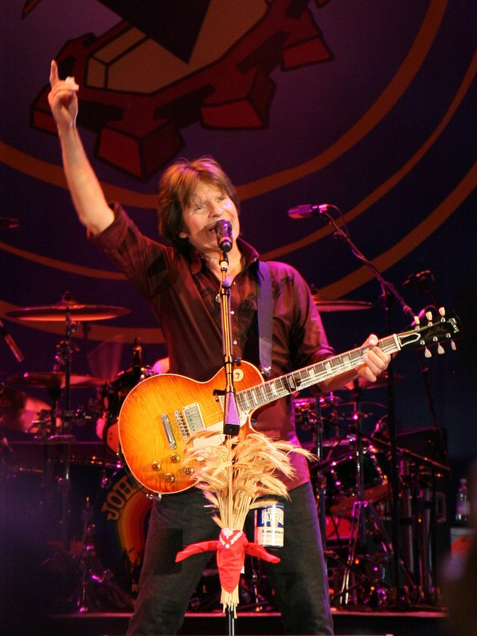 American rock musician John Fogerty, performing at Piazza Napoleone, Lucca, Italy 26/07/2009. (Photo By marco annunziata from Italy - john fogerty, CC BY 2.0)