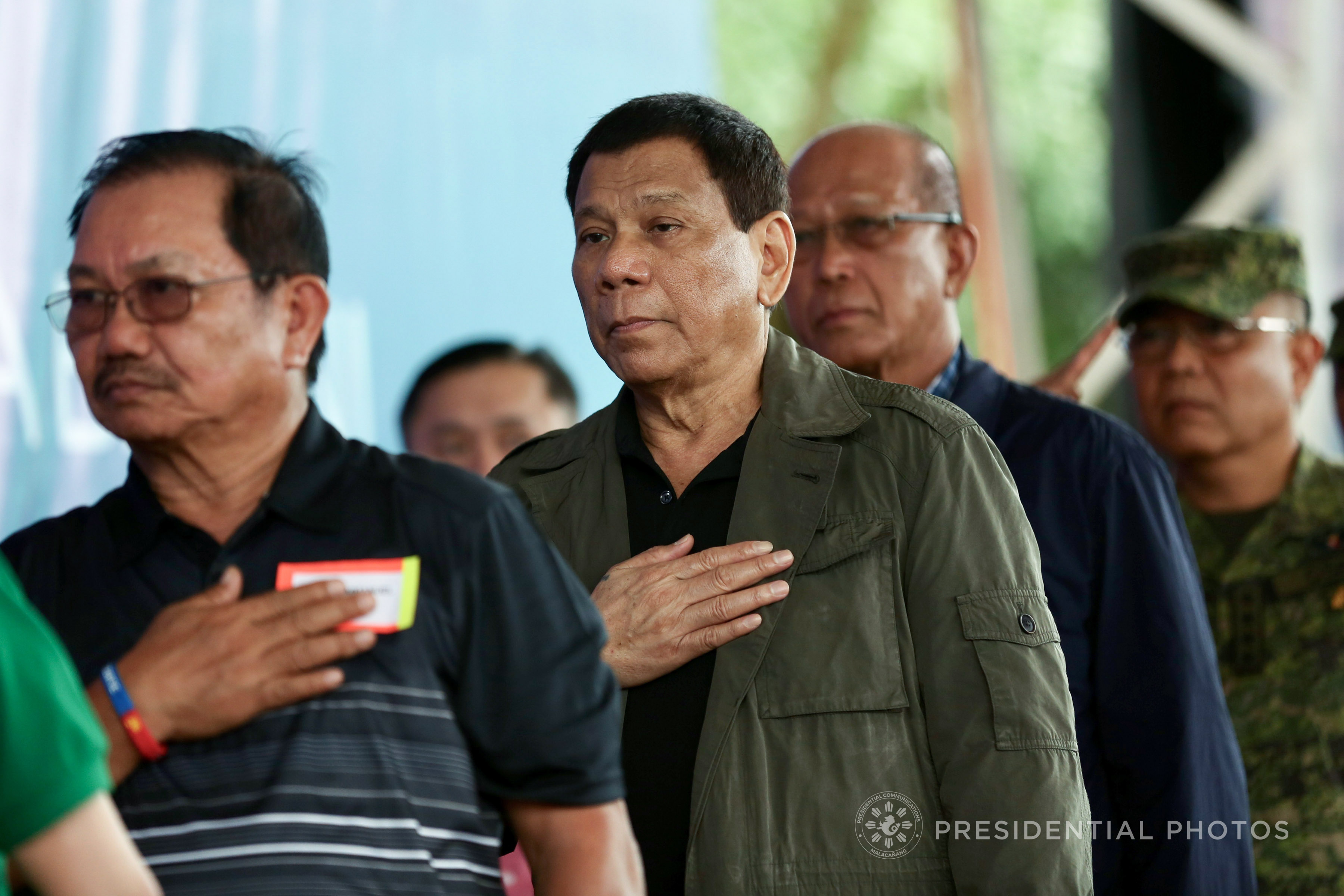 President Rodrigo Roa Duterte sings the Philippine National Anthem during the establishment of the TienDA Para sa mga Bayani at Camp General Manuel Yan in Mawab Sr. in Mawab Compostela Valley Province on January 22, 2018. Also in the photo are Agriculture Secretary Emmanuel Piñol, Defense Secretary Delfin Lorezana and Armed Forces of the Philippines Chief of Staff Rey Guerrero. (Photo by Richard Madelo/Presidential Photo)