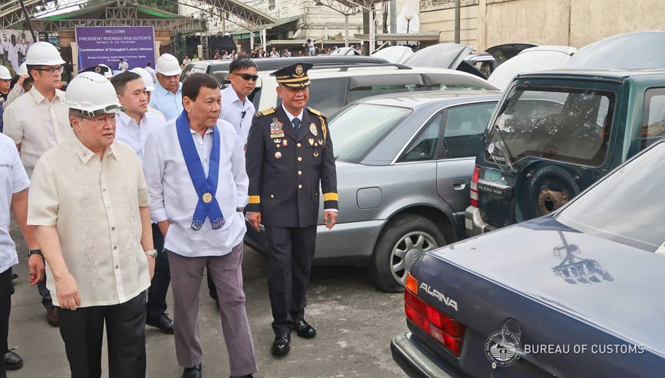 Prrd leads destruction of smuggled luxe cars philippine canadian
