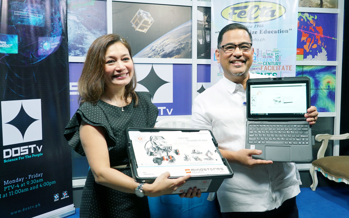 TABLET AND LEGO DONATION. Department of Science and Technology-Science and Technology Information Institute (DOST-STII) Director Richard Burgos and FELTA Multi Media Inc. President and Chief Executive Officer Mylene Abiva displays the study tablet and Lego Robotics, which was donated by FELTA at the DOSTv Studio PAGASA Weather and Flood Forecasting Center in Quezon City on Monday (Feb. 5, 2018). The DOST and FELTA signed a memorandum of agreement for a three-year partnership to build a Center for the Arts in Science and Technology (CAST). (PNA photo by Ben Briones)