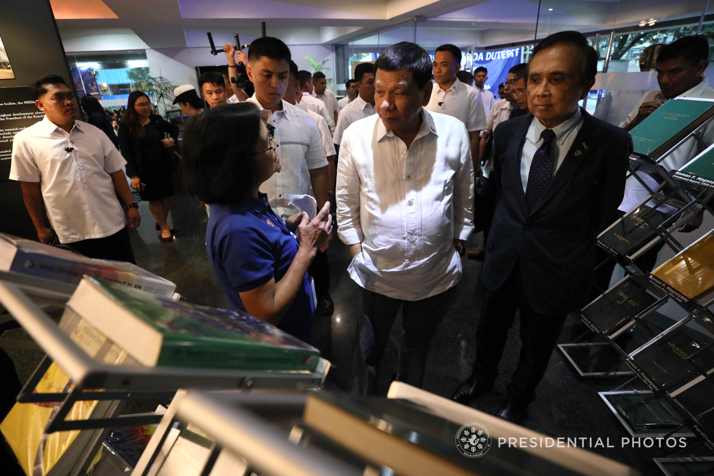 NEDA ANNIVERSARY.President Rodrigo R. Duterte is given a briefing on the history of the National Economic and Development Authority (NEDA) by NEDA Supervising Economic Development Specialist Edita Dumo during the 45th Founding Anniversary of the National Economic and Development Authority (NEDA) at the NEDA Central Office in Pasig City on February 6, 2018. Also in the photo is NEDA Director General Ernesto Pernia. (Ace Morandante/Presidential Photo)