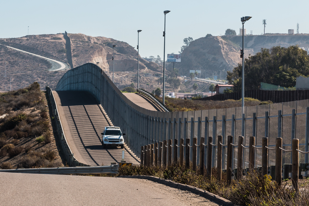 The Trump administration has issued three waivers since August, two to build barriers in parts of California and one in part of New Mexico. President George W. Bush's administration issued the previous five waivers. (Seen in this Shutterstock photo is a Border Patrol vehicle patrolling along the fence of the international border between San Diego, California and Tijuana, Mexico)