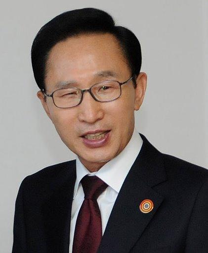 Former South Korean President Lee Myung-bak faces prosecutors over bribery allegations