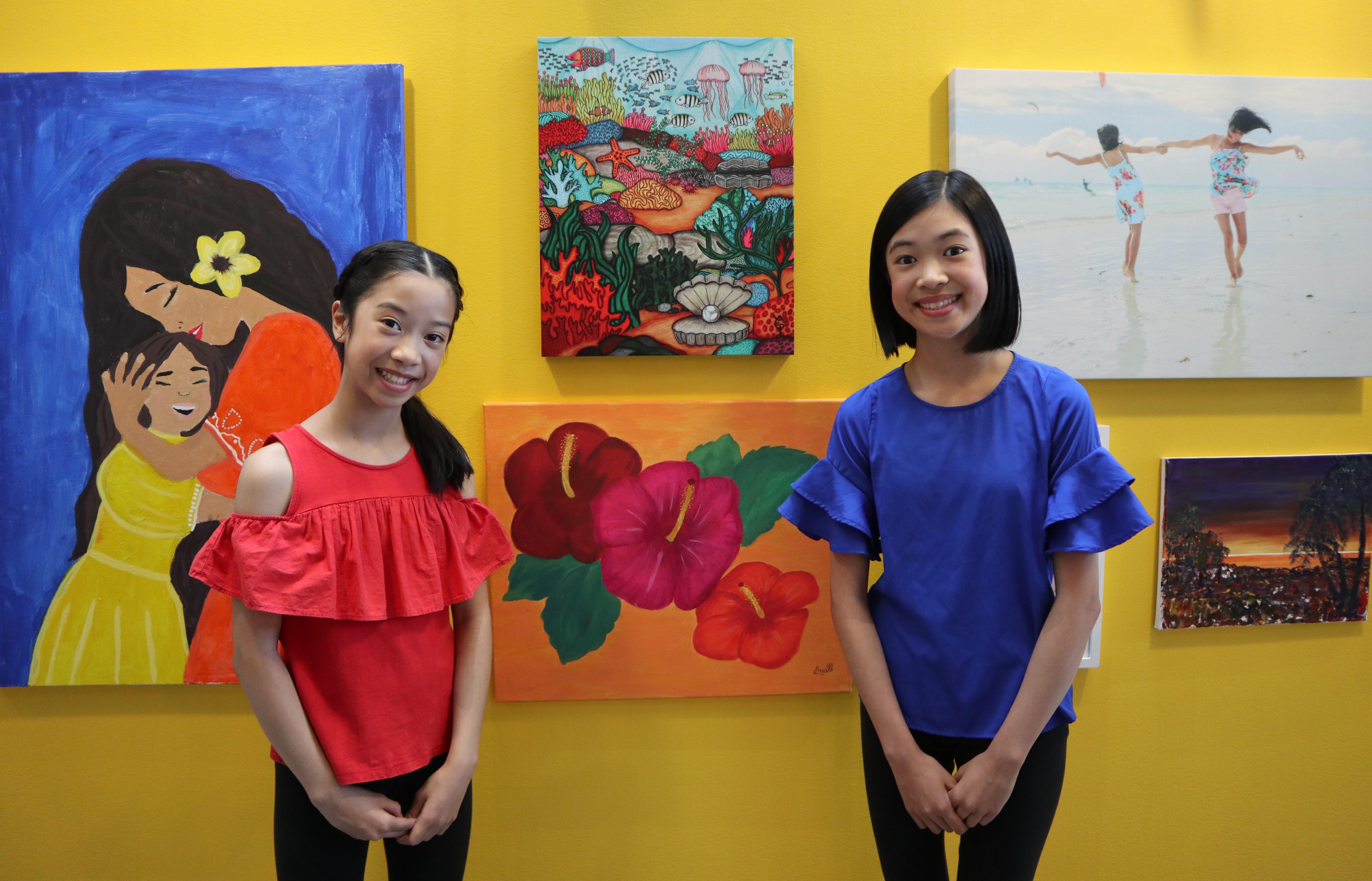 Anya Lavina beside her piece 'Gumamela' (Hibiscus), and